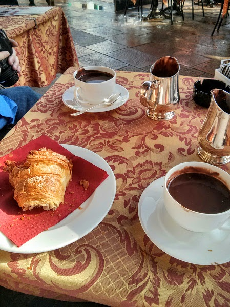 Hot chocolate and croissants on a wet day in Venice